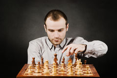 Man at chess board. Chess player at wood chessboard Stock Photos