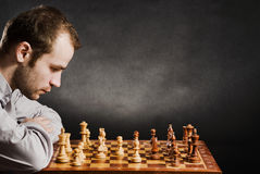 Man at chess board Stock Images