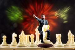 Man on the chess figure Stock Photography