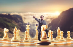 Man on the chess figure Royalty Free Stock Image