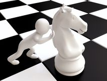 Man and Chess Horse Figure on Chessboard Stock Image