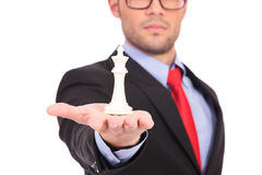 Man with chess king in palm Stock Photo