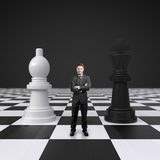 Man on chessboard. Young man standing on chessboard with chess Stock Images