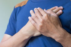 Man with chest pain royalty free stock photos