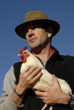 Man and chicken Royalty Free Stock Photos