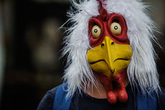 Man with chicken mask Stock Images