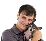 Man with chihuahua pet. Young casual man with his lovely chihuahua dog Stock Image