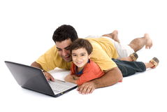 Man and Child. Fun moment between man, child and the laptop Stock Photo