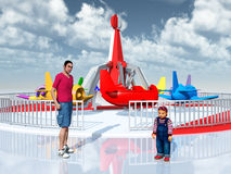 Man, child and amusement ride Royalty Free Stock Images