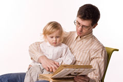 Man and child with book Stock Images
