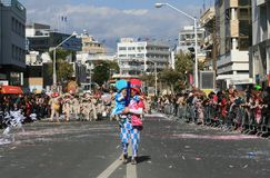 Man with a child in carnival costume walking along a street stock images