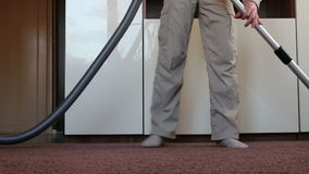 Man with the child clean apartment a vacuum cleaner stock video