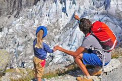 Man with a child at the glacier Royalty Free Stock Photography