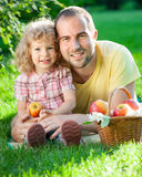 Man and child having picnic Stock Photos
