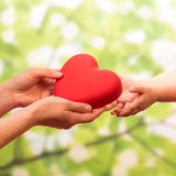 Man and child holding heart Stock Photography