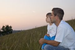 The man with the child look in a distance stock image