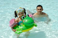 Man and child in pool Royalty Free Stock Images