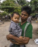 Man with Child. Portrait of Man with child in Mandalay in Myanmar (Burma Stock Image