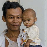 Man with Child. Portrait of Man with child in Old Bagan in Myanmar (Burma Royalty Free Stock Images