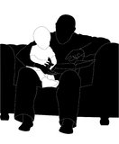 Man and child read the book (silhouette) Royalty Free Stock Image