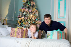 Man and a child received gifts. The father and the son. New year Royalty Free Stock Photography