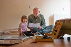 Man with child repairing furniture royalty free stock photos