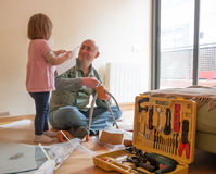 Man with child repairing furniture royalty free stock photography