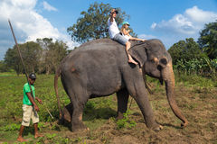Man and child riding on the back of elephant Royalty Free Stock Photo