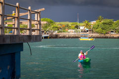 Man and child sea kayaking in Galapagos Islands Stock Images