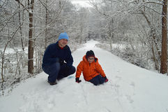 Man and child on snow after storm Royalty Free Stock Photo