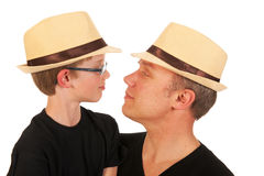 Man and child with straw hats Royalty Free Stock Image