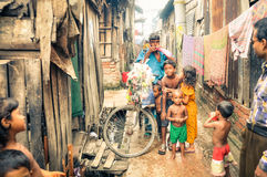 Man and children in Bangladesh Stock Images