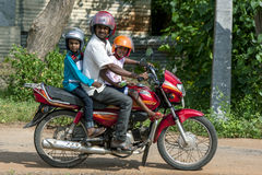 A man with children onboard riding a motorcycle at Puliyankulam in northern Sri Lanka. Royalty Free Stock Photo