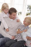 Man and children play together Royalty Free Stock Image