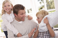 Man and children play together Royalty Free Stock Images
