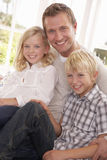 Man and children pose together Stock Photos