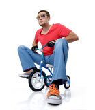 Man on a children's bicycle Royalty Free Stock Image