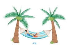 Man chilling  in a hammock  under two coconuts tree Stock Photography
