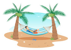 Man chilling hammock  under two coconuts trees Stock Photos