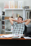 Man chilling out in office Stock Photography