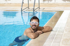 Man chilling in the pool wearing dance party glasses Royalty Free Stock Photos