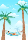 Man chilling using laptop in a hammock under two coconuts tree Royalty Free Stock Images
