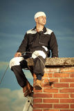 Man on chimney Stock Photos