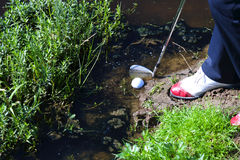 Free Man Chipping Ball From Water Hazard Royalty Free Stock Photography - 55570287
