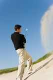 Man Chipping Golf Ball Out Of A Sand Trap Stock Photography