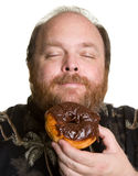 Man with chocolate donut Royalty Free Stock Photo
