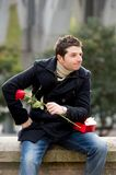 Man with chocolates and a rose being stood up Stock Photos