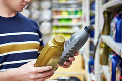 Man choices engine oil in supermarket Stock Images