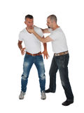 Man choking other man. Isolated on white royalty free stock photos