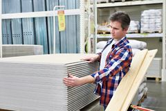 Man chooses and buys drywall in store Stock Image
